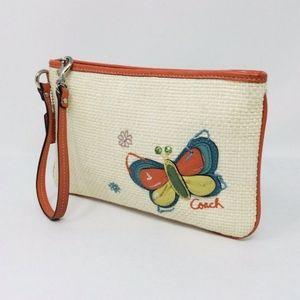 Coach straw wristlet with butterfly appliques